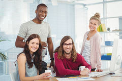 Portrait of smiling business team at computer desk Royalty Free Stock Image