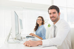 Portrait of smiling business team at desk Royalty Free Stock Images