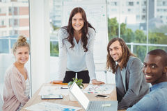 Portrait of smiling business team by desk Royalty Free Stock Photo