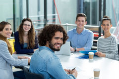 Portrait of smiling business team in meeting Royalty Free Stock Image