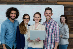 Portrait of smiling business team using laptop Royalty Free Stock Photo