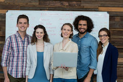 Portrait of smiling business team using laptop Stock Images