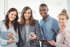 Portrait of smiling business team using technology Stock Photos