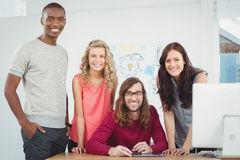 Portrait of smiling business team working at computer desk Stock Photography