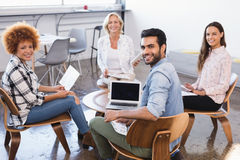 Portrait of smiling business team working together at creative office Royalty Free Stock Image