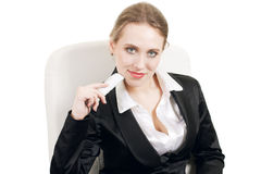 Portrait of smiling business woman. Young business woman with phone smiling, sitting on the chair Royalty Free Stock Images