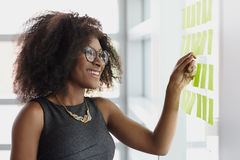 Portrait of a smiling business woman with an afro Stock Image