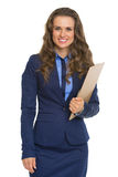 Portrait of smiling business woman with clipboard Stock Images