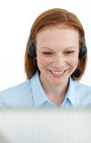 Portrait of a smiling business woman at a computer Royalty Free Stock Photography