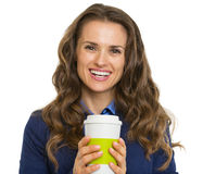 Portrait of smiling business woman with cup of hot beverage Stock Photos