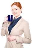 Portrait of smiling business woman with cup, isolated Royalty Free Stock Images