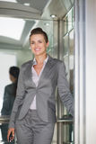 Portrait of smiling business woman in elevator Royalty Free Stock Photo