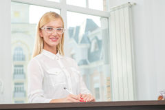 Portrait of a smiling business woman entrepreneur in glasses.  Royalty Free Stock Photo