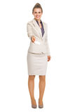 Portrait of smiling business woman giving business card Stock Photos