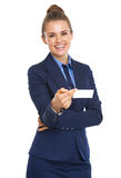 Portrait of smiling business woman giving business card Royalty Free Stock Image