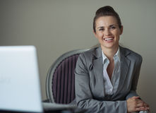 Portrait of smiling business woman in hotel room Royalty Free Stock Photos