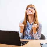 Portrait of smiling business woman with laptop Royalty Free Stock Images