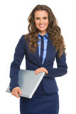 Portrait of smiling business woman with laptop Royalty Free Stock Image