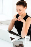 Portrait of smiling Business Woman with a laptop at the Office Royalty Free Stock Photos