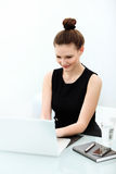 Portrait of smiling Business Woman with a laptop Royalty Free Stock Images