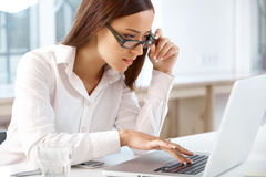 Portrait of smiling Business Woman with a laptop at the Office.  Royalty Free Stock Photos