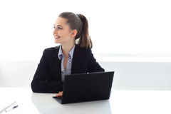 Portrait of smiling business woman with laptop in the office. Portrait of young smiling business woman with laptop in the office Royalty Free Stock Image