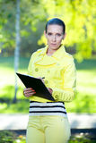 Portrait of smiling business woman with paper folder. Student Royalty Free Stock Image