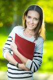 Portrait of smiling business woman with paper folder. Student Stock Photos