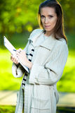Portrait of smiling business woman with paper folder. Student Stock Image