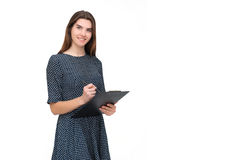Portrait of smiling business woman with pen and paper folder Royalty Free Stock Photos