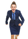 Portrait of smiling business woman running Stock Photography