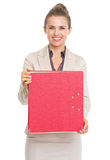 Portrait of smiling business woman showing folder Stock Images