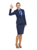 Portrait of smiling business woman showing ok Royalty Free Stock Images
