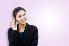 Portrait of smiling business woman using phone Royalty Free Stock Photos