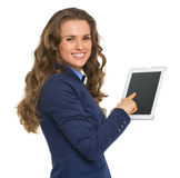 Portrait of smiling business woman using tablet pc Royalty Free Stock Image