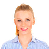 Portrait of a smiling business woman. Wearing a blue striped blouse. Very crisp photo Royalty Free Stock Photo