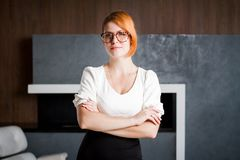 Portrait of a smiling business woman. Wearing glasses Royalty Free Stock Photography