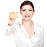 Portrait of smiling woman in a white shirt with credit card stock image