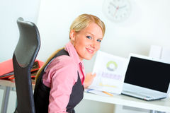 Portrait of smiling business woman at workplace Stock Photos
