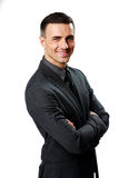 Portrait of a smiling businessman with arms folded Royalty Free Stock Image