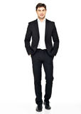 Portrait of smiling businessman in black suit Stock Photo
