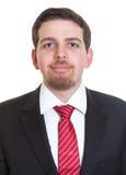 Portrait of smiling businessman in black suit Stock Image
