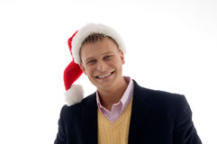 Portrait of smiling businessman with christmas hat stock photo