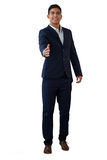 Portrait of smiling businessman extending arms for handshake Royalty Free Stock Photography
