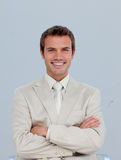 Portrait of smiling businessman with folded arms Stock Image