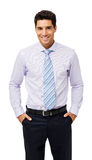 Portrait Of Smiling Businessman With Hands In Pockets. Portrait of smiling young businessman with hands in pockets isolated over white background. Vertical shot Stock Images