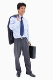 Portrait of a smiling businessman holding a briefcase and his ja Stock Image