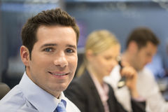 Portrait of smiling businessman in office, looking camera Royalty Free Stock Photo