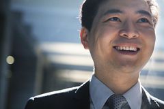 Portrait of smiling businessman in a parking garage Stock Photos