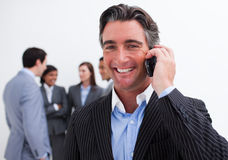 Portrait of smiling businessman on phone Stock Photos
